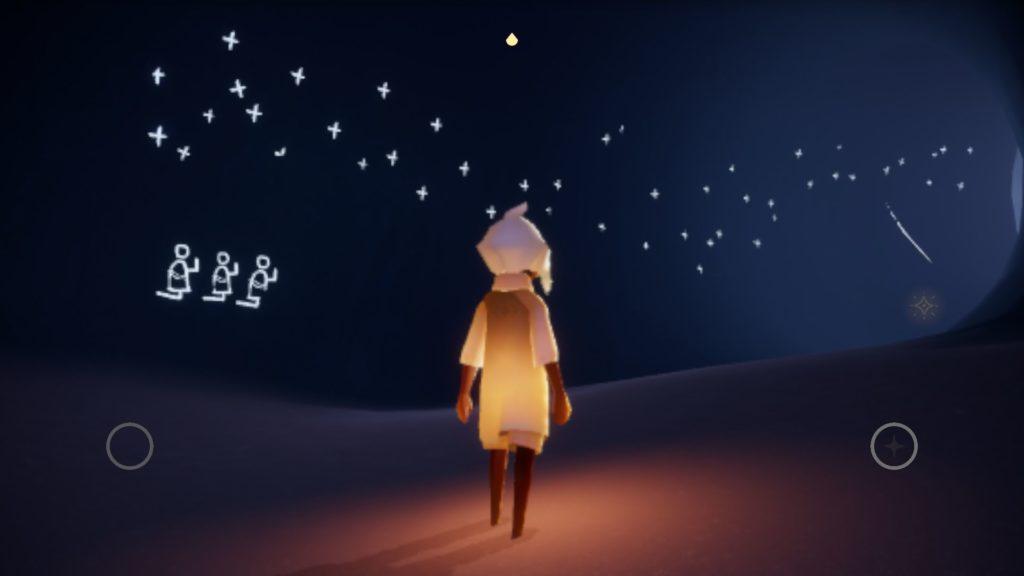 洞窟内に描かれた夜空に礼拝する人たち。